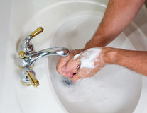 Senior male wash hands with soap Royalty Free Stock Photo