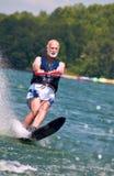 Senior male waterskis