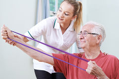 Senior Male Working With Physiotherapist. Senior Male Working With Female Physiotherapist Royalty Free Stock Photos