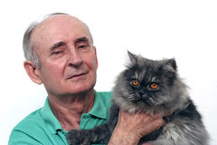 Senior man. Holding his cat Stock Image