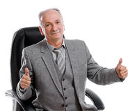 Senior man. Portrait of a handsome old man in a business suit giving the thumbs-up stock image