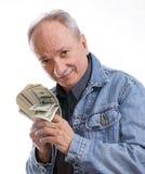 Senior man. Senior businessman with money on white background stock photos