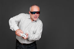 Senior man in 3d glasses playing in video game Stock Images