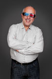 Senior man in 3d glasses standing Stock Photo
