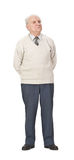 Senior man. Wearing a sweater standing-up against a white background Royalty Free Stock Photo
