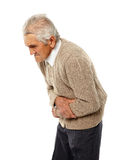 Senior man with abdominal pain. Old man with severe abdominal pain isolated on white stock photo