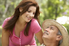 Senior Man With Adult Daughter In Garden stock photo