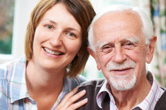 Senior Man With Adult Daughter At Home Stock Photos