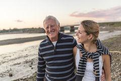 Senior father With Adult Daughter At Sea. A Senior Man With Adult Daughter At Sea Royalty Free Stock Images