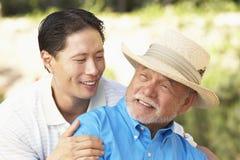 Senior Man With Adult Son In Garden Stock Photos