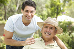 Senior Man With Adult Son In Garden Royalty Free Stock Photo