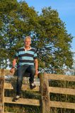 Senior man on fence Royalty Free Stock Images