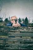 Senior man aiming a gun Royalty Free Stock Image