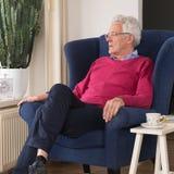 Senior man alone in interior royalty free stock image
