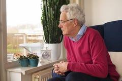 Senior man alone in interior stock photos