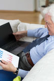 Senior man analyzing a chart Stock Photo