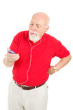 Senior Man Annoyed by MP3 Player Royalty Free Stock Images