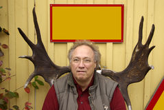 Senior man with antlers of a moose Stock Image