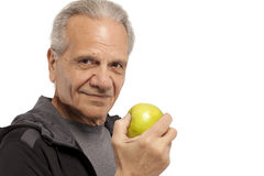 Senior man with an apple Stock Image