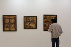 Senior man at art exhibition Stock Photos