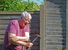 Senior man arthritis elbow. Royalty Free Stock Images