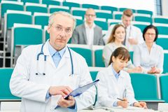 Senior man as doctor or physician. Senior men doctor or physician as medicine lecturer or professor Royalty Free Stock Photo