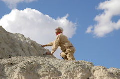 Senior Man Ascending. A high mountain. to see all four images in this series keyword: khaki/man Royalty Free Stock Image