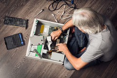 Senior Man Assembling A Desktop Computer Royalty Free Stock Image