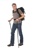 Senior man with backpack and hiking poles Stock Photography