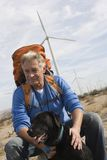 Senior Man With Backpack Near Wind Farm Stock Photos