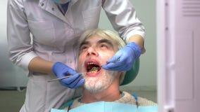 Senior man with bad teeth. stock footage