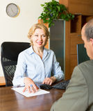 Senior man with bank manager Stock Image