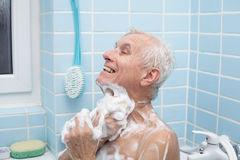 Senior man bathing stock photography