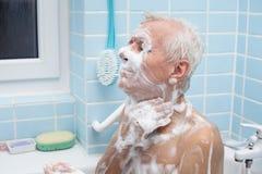 Senior man bathing Stock Photos