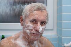 Senior man bathing Stock Photo