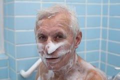 Senior man bathing Royalty Free Stock Image