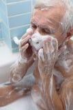 Senior man bathing Royalty Free Stock Photo