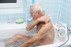 Senior man bathing Royalty Free Stock Images