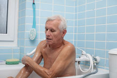 Senior man bathing Stock Images
