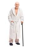 Senior man in a bathrobe holding a cane Royalty Free Stock Photo