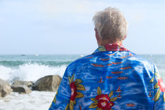 Senior man at the beach Stock Photo