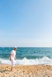 Senior man at the beach Stock Images
