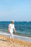 Senior man at the beach Stock Photography