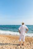 Senior man at the beach Stock Photo