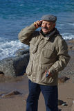 Senior man talking by mobile phone Stock Photography