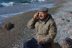 Senior man talking by mobile phone Stock Photo