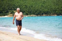 Senior man on the beach Royalty Free Stock Image