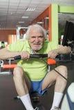 Elderly man in the gym Stock Photos