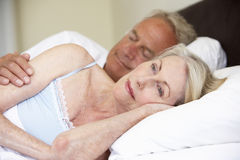 Senior Man In Bed With Worried Wife Stock Photos