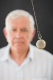 Senior man being hypnotized with pendulum Stock Photography